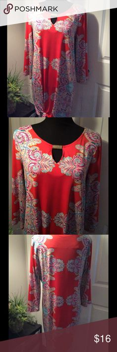 Sunny Leigh Dress Size Medium This Red and multicolored dress is BEAUTIFULLY CLASSY and COMFORTABLE!  95% poly & 5% Spandex. It is a Medium but is on the larger size of Medium. This is a real head turner. Length of dress is 30 inches. Go ahead!  Treat yourself!  Thank you for shopping with Boutique Treasures 🌸. Sunny Leigh Dresses Midi