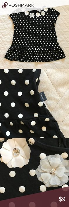 DKNY Girls Top Polka Dot Peplum Black & White XL Black and white polka dot print peplum top by DKNY.  Has white flowers decor at neckline with sequins and rhinestones in the center.  Exposed back zipper at back of neck.  Very good pre-owned condition: does have a tiny repair on one shoulder where there was a tiny hole.  Feel free to bundle this item with other great kids items from my closet! DKNY Shirts & Tops Blouses