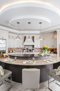 If you're looking to add personality to your kitchen layout, a circular island may be for you. The design can go full circle or feature a half-moon.