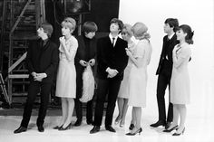 LONDON—The Beatles onstage with their individual makeup artists during the filming of A Hard Day's Night, 1964.