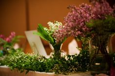 Garden style head table at wedding.
