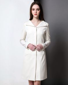 Inspired by Kate Middleton's dress when she wore it to Prince George's christening. A great dress to transit between seasons or on cool summer evenings. In a neutral off-white shade, this coat dress will look complement floral or monochrome separates and dresses. Featuring a unique wide neck with concealed button closure, the dress is sculpted with the style lines to fit the contour of your body. You can even wear it on its own.