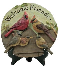 """Welcome Sign With Cardinal Pair by Banberry Designs. $23.99. Measures 11"""" Diameter. Perfect gift for bird lovers. Intricate, detailed sculpting very realistic birds. Wall hanging hook on back for indoor use. Polystone Welcome Plaque for garden or bird lover. Welcome Friends Polystone plaque, wall hanging hook on back. Display on the wall, on an easel, or in your garden. Easel not included 11"""" Diameter"""