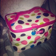 Cute Polka Dot Cosmetic Bag Cute gently used cosmetic bag! Few makeup marks on the inside, I'm sure most can wipe out with soapy water/magic eraser, but cute cute bag to carry all your essentials in!! Zipper works perfect, handle still in tact!! I will try to clean as much as possible before shipping! Open to offers! N/A Bags Cosmetic Bags & Cases