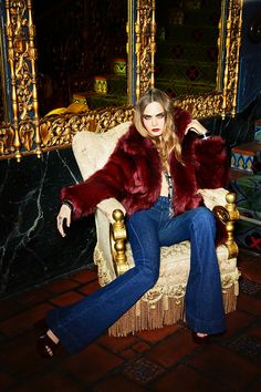 Cara Delevingne for Bo.Bo. Luxury looking, provocative and sophisticated shot, maybe a little bling, with red fur and vampire looking make up.
