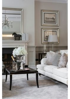Silver frames from hall, add a rail with darker paint below and pale on top. Paint fireplace and retile.