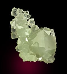 Neat cluster of bi-pyramidal pale greenish translucent glassy quartz crystals measuring 8.2 x 5.2 x 3.9 cm in size overall. The largest crystal measures 3.5 cm in size. This is completely crystallized all around 360 degrees. No damage; contacted on the base of the specimen. This is very choice for the species/locality. Ex Lloyd Tate collection. Ref: The Mineralogical Record (2001): 32: 3.   Copyright © Dan & Diana Weinrich Minerals
