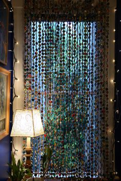 Now this is cool.  Curtain from bottle caps!