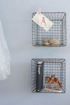 wire baskets as shelving nooks  superb idea!