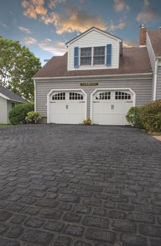 Pave the way to your dream driveway. This driveway was updated with beautiful Cambridge Pavingstones with ArmorTec. What would your entryway look like with pavers?