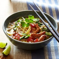 Vietnamese Pork-and-Noodle Soup | In many Asian cultures, long noodles symbolize long life. And in the spirit of that tradition, we've left the past whole here, to be eaten with chopsticks or even a fork.