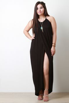 This plus size maxi dress features a halter neckline with adjustable tie at back, sleeveless design, high-cut slit at front, and asymmetrical hemline. Accessories sold separately. Made in U.S.A. 95% R
