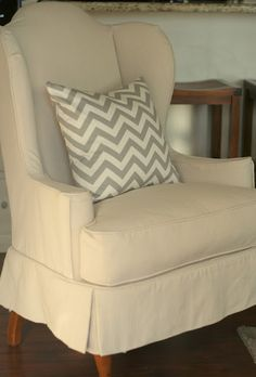 Drop Cloth Covered Chair for your master bedroom.  just find a good wingback on the classifieds, get a big dropcloth at hardware store and make (or have made) a tailored slipcover.