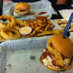 Cheesy Haystack burger with onion rings and hand-cut fries at Mojo's in Simpsonville, SC. Yummy!