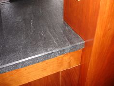 Virginia Mist Granite against wood cabinets Granite Countertops Colors, Split Foyer, Banquette Seating, Wood Cabinets, Bay Window, Kitchen Backsplash, Kitchen And Bath, Great Rooms, Home Remodeling