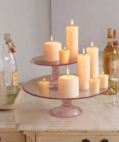 Super cute & clever. Candles arranged on a cake stand.