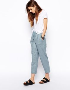 cool, comfortable outfit (white top, blue pants, black birkenstocks)