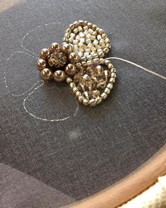 Sewing a beaded brooch using an embroidery hoop to keep the fabric base flat. Bead Embroidery Patterns, Tambour Embroidery, Couture Embroidery, Bead Embroidery Jewelry, Embroidery Fashion, Hand Embroidery Designs, Beaded Jewelry, Brooches Handmade, Handmade Jewelry