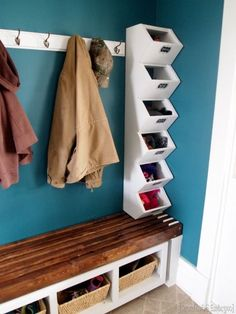 A stack of bins fits easily into a skinny space. Not only do they help organize your many scarves and mittens — they also add interest to an otherwise boring wall. See more at Sawdust and Embryos »
