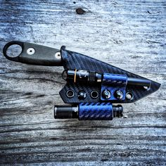 Custom ESEE Izula Sheath with Olight i3s and EXOtac ferro rod attachments by Armatus Carry Solutions