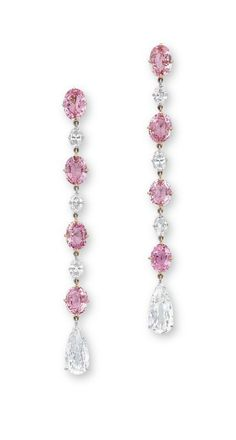 A PAIR OF PADPARADSCHA SAPPHIRE AND DIAMOND EAR PENDANTS  Each set with a line of oval-shaped padparadscha sapphires weighing approximately 1.58 to 1.26 carats, alternating with oval-shaped diamonds, terminating in pear-shaped diamonds, mounted in 18k rose and white gold