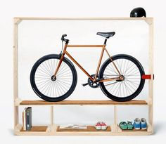 "Love the way this piece of furniture ""frames"" the bike, and keeps accessories organized and close at hand."