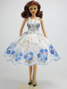 "Blue flowers by Hankie Couture, delicate and lovely! A dress from a vintage hanky, to fit 11 1/2"" Barbie, my custom-designed Hankie Couture doll (shown here), and similar sized dolls! #Hankiecouture #doll #hankie #hanky"
