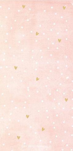 motifs petits coeurs et points blancs sur fond rose pastelle.