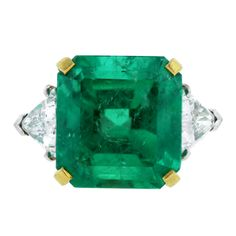 Radiant Cut Emerald Trillion Cut Diamond Gold Platinum Ring | From a unique collection of vintage three-stone rings at http://www.1stdibs.com/jewelry/rings/three-stone-rings/