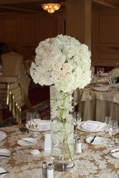 All white elegance with submerged orchids Floral creation by Karla Cassidy Designs www.karlacassidydesigns.com