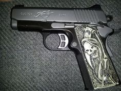Love the grips. How cool would those be on a full size 1911