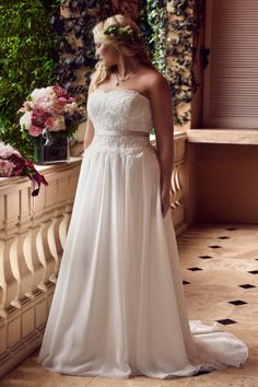 Casablanca 2239 | The relaxed flow of this chiffon a-line gown is designed with a delicately beaded lace bodice, a straight across neckline, and is finished with a detachable sash.  Gown available in Ivory/Ivory, Champagne/Ivory, White/White  *Gown pictured in Champagne/Ivory  Gateway Bridal | Utah Wedding Dress | SLC | Wedding Inspiration | Wedding Dress Goals | Dream Wedding | Plus Size Bride | Strapless