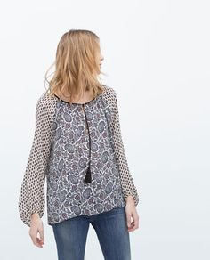 PRINTED SHIRT WITH PUFFED SLEEVES AND TASSELS