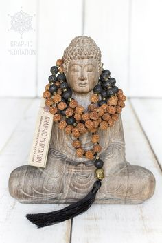 This long mala necklace is made with natural rudraksha seeds and black lava stones. Each bead is individually hand knotted. Mala beads are worn on the neck or left wrist while not in use. It may also serve as a nice accessory in everyday life or on some special occasions. DETAILS: • Length: 26 (67cm) | Diameter: 45 (114cm) | Tassel: 3 (8cm) • 108 beads plus 2 beads in the tassel | Width: 8-9 mm • High quality natural rudraksha and black lava rock stone • The tassel is designed and ...