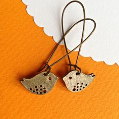 $7.00.  BABY BIRDIES earrings on French wires.  Love these, own these, adore the price and vendor.