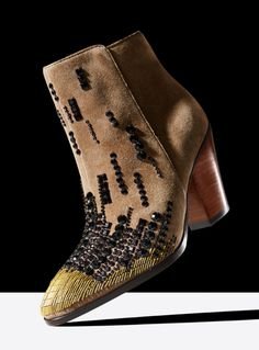 Beading adds interest to an otherwise basic brown ankle boot, by Donald J Pliner