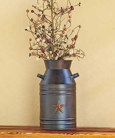 """Display this Rustic Star or Milk Can Decor in any room to accent it with a wholesome country look. The weathered Rustic Star (15""""W x 2-1/4""""D x 15""""H) looks at home over a fireplace or on a porch wall."""