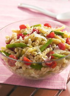 Two kinds of string beans and tomatoes add color and crunch to this summery pasta salad seasoned with tarragon vinegar and shaved Parmesan.