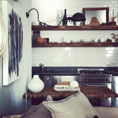 kitchen. subway tile and butcher block with stainless steel cabinetry