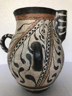 Pottery Ancient.Three-handled jug in Greek – Kamares style.Minoan vase