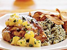 Grilled Chicken with Mango-Pineapple Salsa | Top grilled chicken breast halves with a sweet-and-spicy tropical salsa of fresh pineapple, mango, jalapeño peppers, and cilantro.  Serve over rice for an easy one-dish meal.