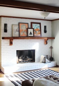 white-painted brick fireplace with wood mantle. maiedaie.