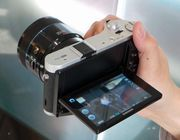 The Samsung NX300 brings a couple of novel features to the company's NX line of mirrorless cameras: Wi-Fi and the ability to shoot 3D with a special lens.