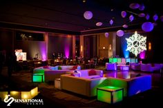 Lounge seating and LED cubes with ceiling decor create a FUN party room.  Photo courtesy of Hollye Schumacher Photography. More Mitzvah event images at http://www.sensationalevents.com/mitzvahs.