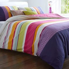 or maybe a brightly coloured dufet with hints of the colour within it around the room