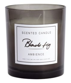 Scented candle in a glass holder with a decorative label. Diameter 3 1/4 in., height 3 1/2 in. Burn time 30 hours.