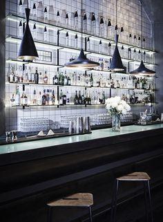 Zoo Bar featuring Frama Adam stools, Diamond lights, and E27 Wall lights. Shot by Claus Troelsgaard