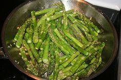 Asparagus 1 large bunch of asparagus, washed, snapped and cut in half  1 teaspoon to 1 tablespoon chopped garlic  Fresh ground black pepper Sprinkle of salt  Butter or Coconut oil...