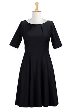 Black fit and flare with elbow-length sleeves. Would look cute with my new black wedges, the peacock pin, and big curls.