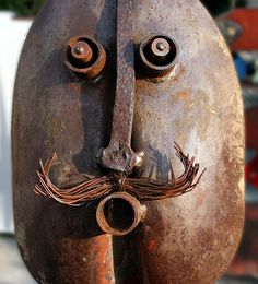 How about garden art from an old shovel? A fun way to repurpose that rusty old shovel.